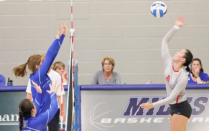 Lady Trapper Eirini Matsouka goes up for a spike during a Wednesday game at Miles Community College. The NWC volleyball team will host MCC tonight (Tuesday) in the team's home opener at Cabre Gym.