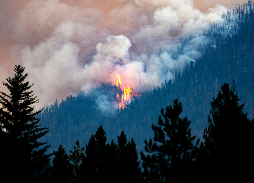 Fire in the Washakie Wilderness of the Shoshone National Forest is visible from the North Fork Highway on Tuesday. After being discovered Monday afternoon, the fire had burned through 10,321 acres by Wednesday night. The fire is moving down the Fishhawk Creek drainage toward the corridor.