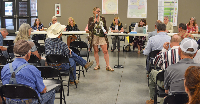 Short-term rental owner Cherie Fisher of Cody addresses Park County officials and the audience at an Aug. 22 meeting at the fairgrounds. Fisher spoke about what a positive experience she's had renting out property on a short-term basis.