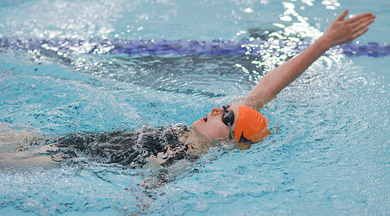 PHS swimmer Emma Mitchell competes in the 100 backstroke Thursday against Worland at the Powell Aquatic Center. Mitchell recorded a personal best in the event. The Lady Panthers are on the road today (Tuesday) for a dual meet against Cody.