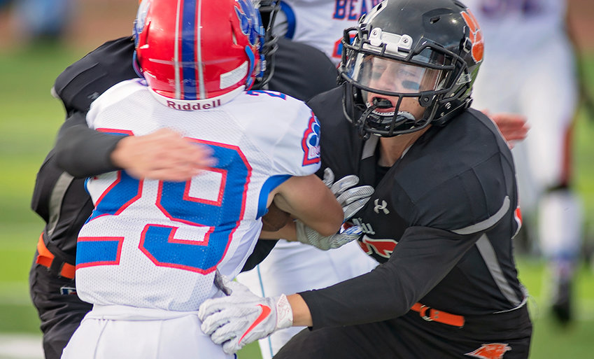 Panther defensive back Kobe Ostermiller and a teammate stop Douglas' Rylan Wehr in his tracks during Friday's game at Panther Stadium. The Panthers lost 13-7 to drop to 2-1 on the season.