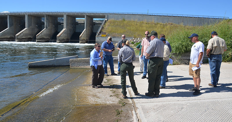 Work to repair the boat ramp at the Afterbay river launch in the northern part of Bighorn Canyon National Recreation Area is getting underway. Officials met at the site earlier this year to discuss the improvements.