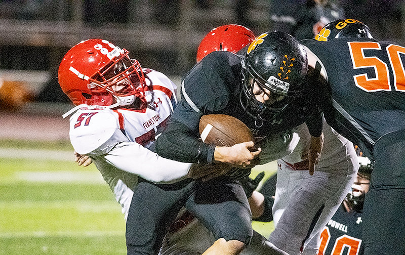 PHS running back Brody Karhu plows through the tackle of Evanston's Sean Knighton en route to a score during the Panthers' 20-7 win over the Red Devils at Panther Stadium last week. Karhu and his teammates travel to Afton on Friday to take on defending 3A state champion Star Valley, currently ranked first in the state.