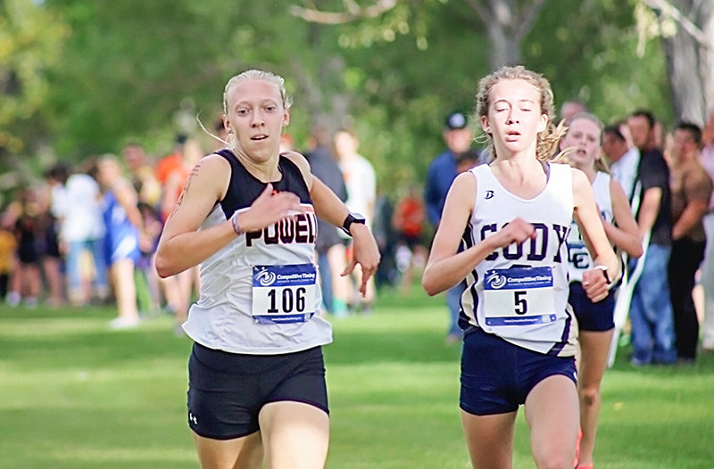 PHS cross country runner Kayla Kolpitcke keeps pace with Cody's Ashton Powell at the Warrior Invite in Worland last month. Kolpitcke was the top finisher for the Lady Panthers at Friday's Foxes and Hounds meet in Cody, placing 10th with a time of 21:14.73.