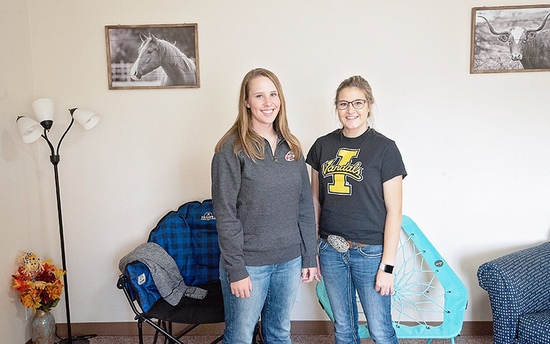 From left, Northwest College students Kate Aisenbrey and Jordan Grindheim pose for a picture in their Trapper Village apartment. They placed second in an NWC room decorating contest earlier this month.