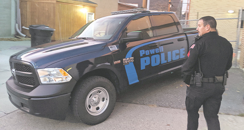 Powell Police Sgt. Matt McCaslin heads to his new, 2019 Dodge Ram during an open house at the Powell Police Department on Thursday. With its blue paint scheme, the truck differs from the white cars and trucks that make up the rest of the department's patrol fleet. But the fleet may undergo a shift in the coming years, as vehicle manufacturers make fewer sedans and wrestle with emission standards.