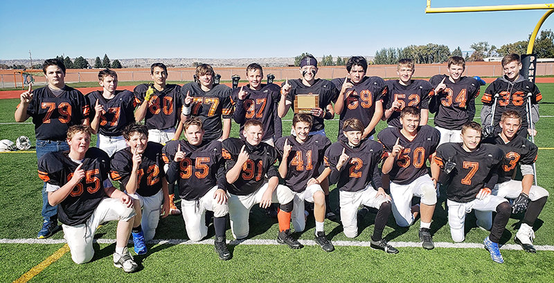 The Powell Middle School eighth grade football team poses with its trophy after winning the conference title. Pictured from left are: (standing) Emmett Clayton, Kolby Crichton, Merced Jordan, Seston Shoopman, Devin Kokkeler, Jhett Schwahn, Adam Flores, Wyatt Blackmore, Brock Johnson and Trey Stenerson; and (kneeling) Heath Drayvon, Joe Bucher, Ryder Keefer, Austin Preator, Case Bradish, Rayce Degraffenreid, Aiden Greenwald, Carson Lawrence and Tyler Wood.