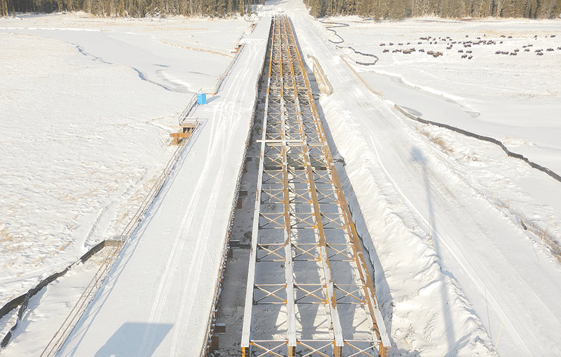 Despite snow, work continues Tuesday on a viaduct that will span the Pelican Creek area east of Fishing Bridge and reconnect a couple acres of wetland in Yellowstone National Park. It's three major road projects set to start or continue in Yellowstone next year.