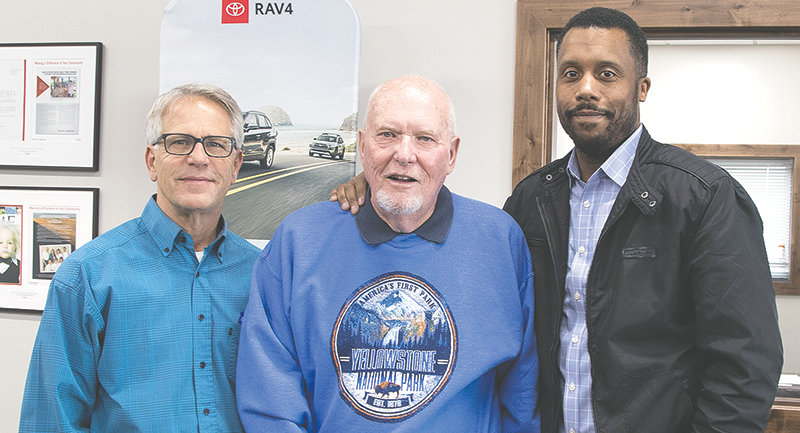 The Garvin Motors tandem of Marty Bratt and Rod Garvin (from left) are pictured with Anthony Brownlee, owner of newly-named Yellowstone Motors. In recognition of the change in ownership and the change in name, Garvin wears his Yellowstone Park sweatshirt.