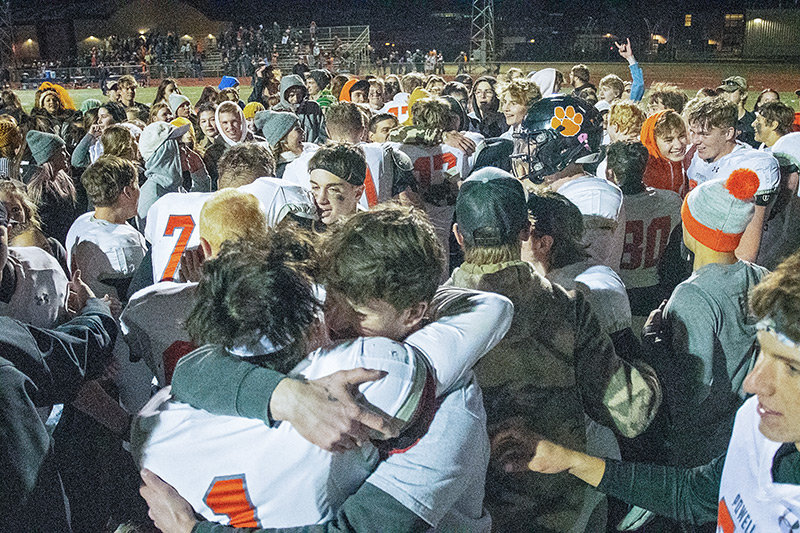 Powell Panther parents, fans and members of the PHS student body celebrate on the turf of Spike Vannoy Field Friday following the Panthers' stunning 20-13 upset of Cody. Powell will play Star Valley this Friday for the 3A State Championship.