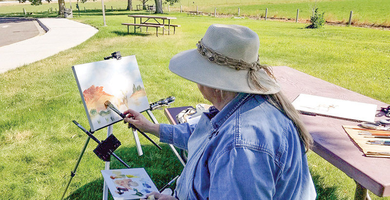 Lovell artist Bobbie Brown demonstrates painting techniques at the Bighorn Canyon National Recreation Area Visitor Center during her stint as an artist-in-residence at the canyon this summer. Bighorn Canyon officials are seeking new artists for 2020.