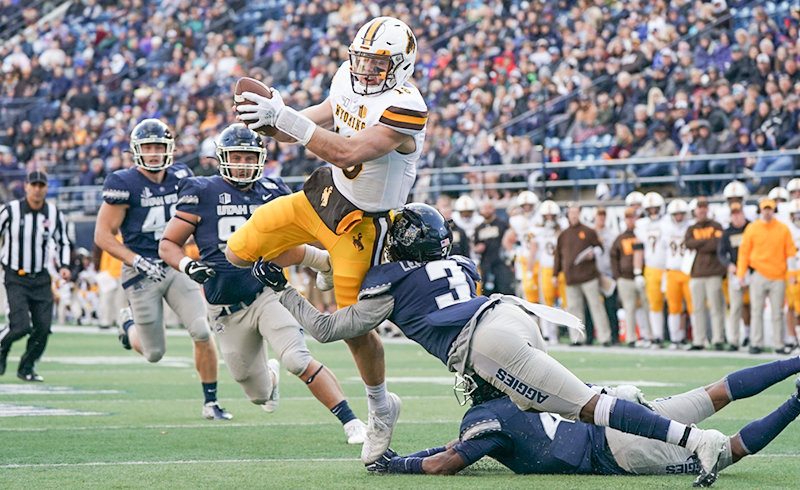 University of Wyoming quarterback Tyler Vander Waal leaps for extra yardage during the Cowboys' 26-21 loss to Utah State last week. Vander Waal and the Pokes will host Colorado State University on Friday night for the annual Border War.