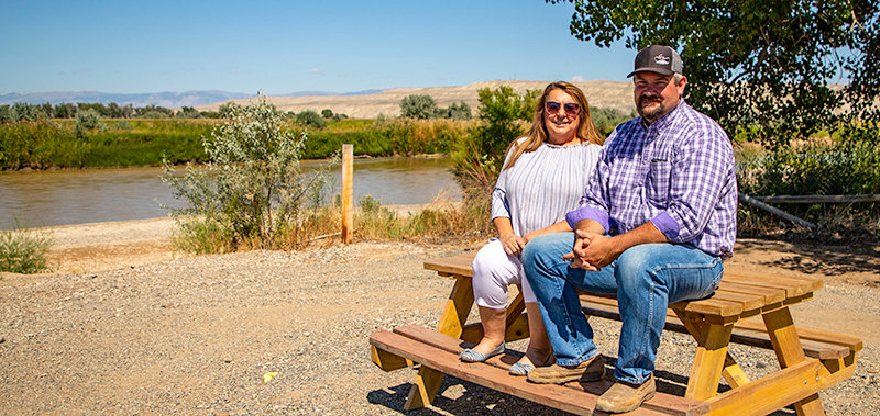 Basin is receiving $10,000 to enhance its boat dock area, which has been underutilized over the years. Barbara Anne Greene (left), president of the Basin Area Chamber of Commerce, and Basin Mayor CJ Duncan are pictured at the area. 'It's just a hidden gem within the town of Basin,' Greene said.