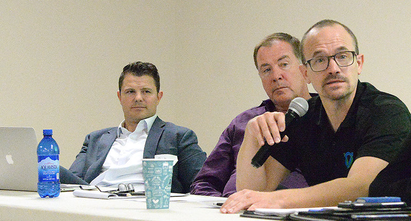 Erick Shutte of OptiVerde Systems (at right) speaks during a panel discussion at the recent Big Horn Basin Hemp Connect Forum, while Scott Schwab (at left) and Dal Tenhulzen (middle) listen. The PEP-hosted event at the Park County Fairgrounds brought out about 75 people to learn about a potential hemp industry in Wyoming.