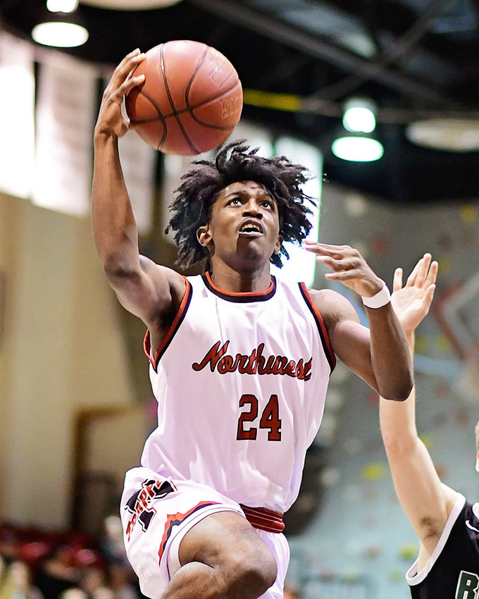 Eric Jackson, an NWC sophomore from Aurora, Colorado, drives to the rim in a recent Trapper home win over Rocky Mountain JV. The Trappers beat the Battlin' Bears in Billings on Monday.