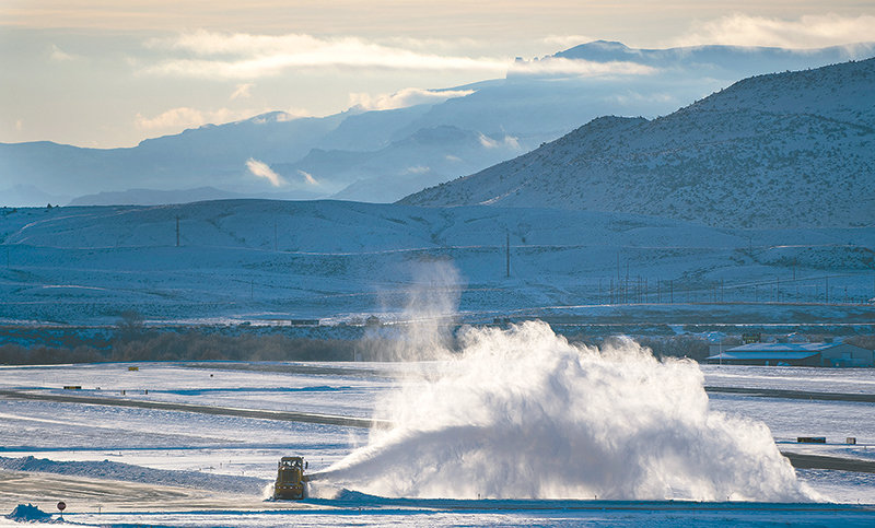 A snowplow clears the runway at Yellowstone Regional Airport last week. Winter weather can cause delays at the Cody airport — particularly because of the terrain surrounding the facility — but moving to a new location would be cost-prohibitive.
