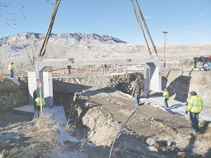 With assistance from JMS Crane Service out of Billings, Park County Road and Bridge crews work to install a new concrete section as they replace a bridge on Beverly Drive (Road 6OS) on the South Fork earlier this month. The work was funded by a 1 percent specific purpose sales tax, being among a list of projects that voters approved in 2016. In 2020, county commissioners may ask voters to approve a general purpose tax that could be used more broadly.