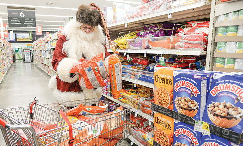 Santa Claus stopped by Blair's Super Market on Monday to purchase non-perishable food for Powell Valley Loaves and Fishes.