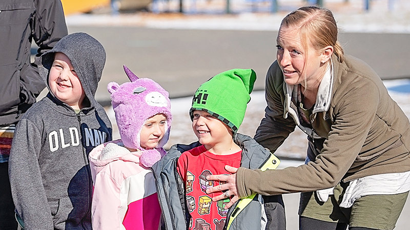 Parkside kindergarten teacher Kaylyn Ramsey (at right) is pictured with students Michael Long, Lily-Anna McKinny and Kaden Cook during a bus safety drill in October.
