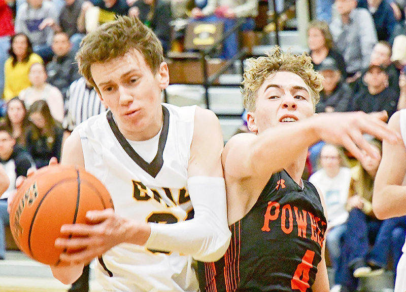 Powell's Mason Marchant (4) battles Rocky Mountain Grizzly Zach Simmons for a rebound Tuesday night at Cowley. Marchant led Powell with 13 points. Simmons accounted for 11 of Rocky's points in the Grizzlies' 65-40 win.