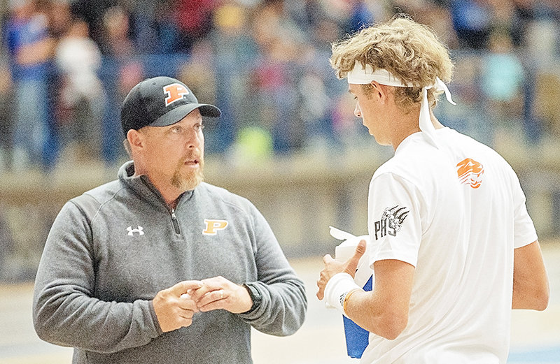PHS head tennis coach Joe Asay, pictured talking with senior Jesse Brown at the 2019 state tournament, was recently named the Boys' Tennis Coach of the Year by the Wyoming Coaches Association.