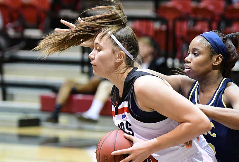 Northwest College freshman Riley Aiono, who had six points and six rebounds, is closely guarded by Ja'Kia Wells of the Golden Eagles in Wednesday's game. The conference season opened with a 77-73 win for Laramie County.
