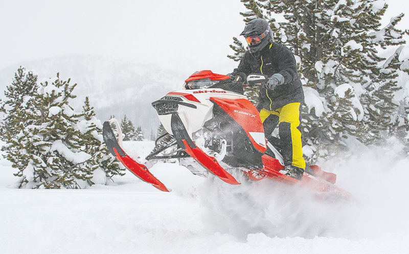 Tate McCoy gets some air while riding his sled after avalanche training organized by the Cody Country Snowmobile Club. Dozens of club members, area riders and search and rescue volunteers participated in the training.