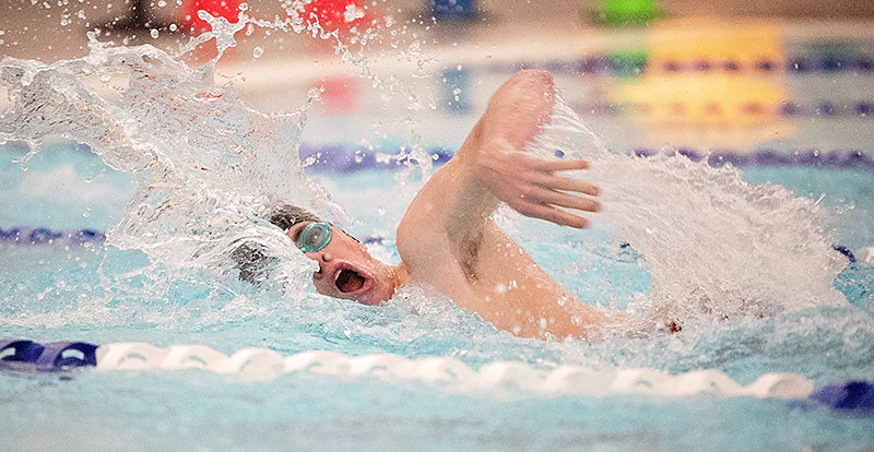 Bryce Hogen swims a leg of the 400 freestyle relay in a Friday night dual against Lander at the Powell Aquatic Center. The team of Hogen, Ru Parker, Ben Cannizzaro and Nate Johnston took fourth in the event.