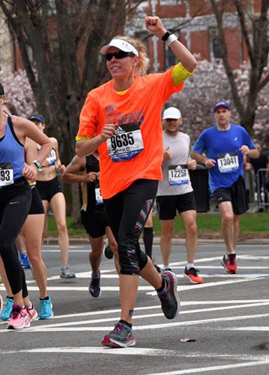 Jenne Wittwer is pictured running in the Boston Marathon on April 15, 2019.