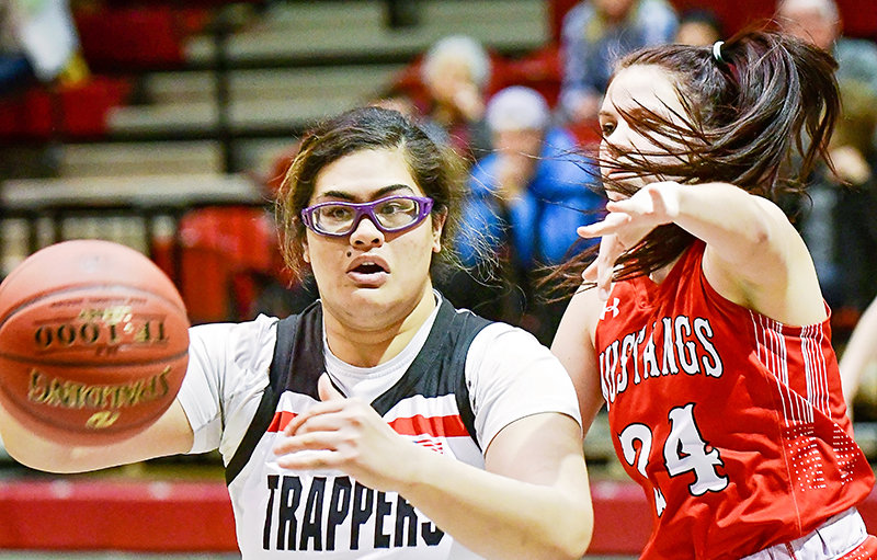 Trapper Lucy Tuigamala, guarded here by Melynda Davison of Cowley, had one of her best games in NWC's 83-68 win over Western Wyoming.