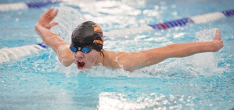 PHS swimmer Kyler Warren swims the butterfly leg of the 200 individual medley Tuesday evening at Powell Aquatic Center, finishing fifth. Warren came in first in the 500 free and narrowly missed qualifying for state in that event.