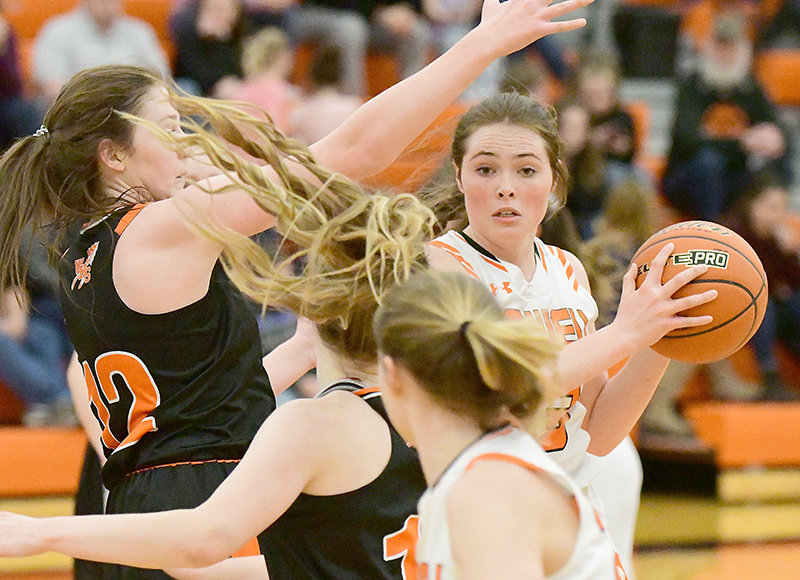 Paije Johnson, a Panther junior, finds herself in the thick of it during her team's Friday game against 3A No. 6 ranked Worland. The powerhouse Warriors prevailed in this one, 46-20.