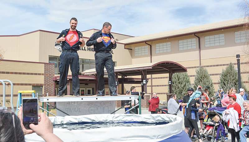 Powell police officers Trevor Carpenter and Matt McCaslin show off superhero costumes before jumping into a pool of chilly water at last year's Jackalope Jump at Powell High School. Organizers are hoping to draw at least 20 teams for this year's event, set for March 27.