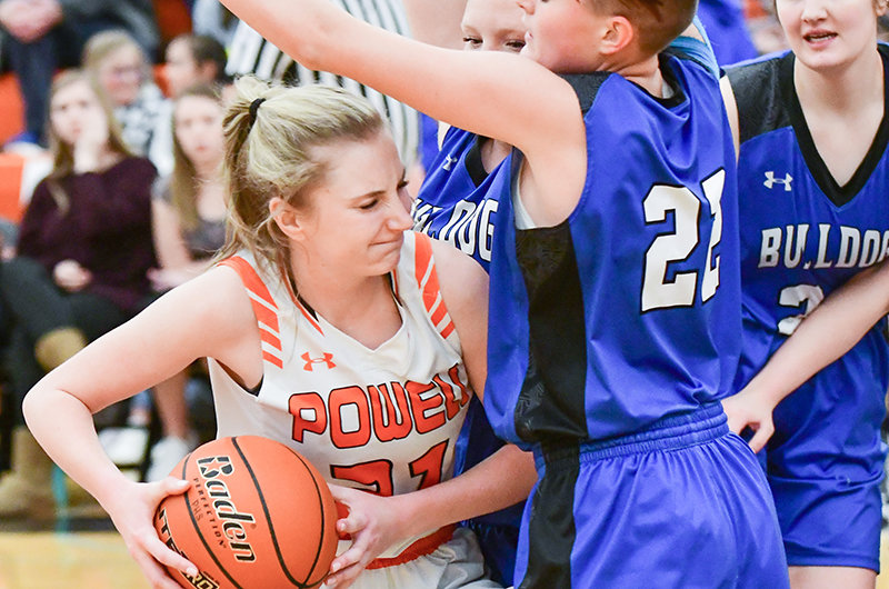 The path to the basket for Panther Hailee Hyde is slammed shut by Lovell defenders in Friday's 37-33 PHS win. Hyde had three points.