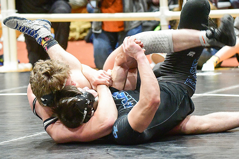 This Bo Dearcorn pin of Cheyenne East 170-pounder Blaise Ronnau won him the championship and provided the final six points to propel the Panthers to third place in the prestigious, all-class, 40-plus team Ron Thon Memorial at Riverton on Saturday.
