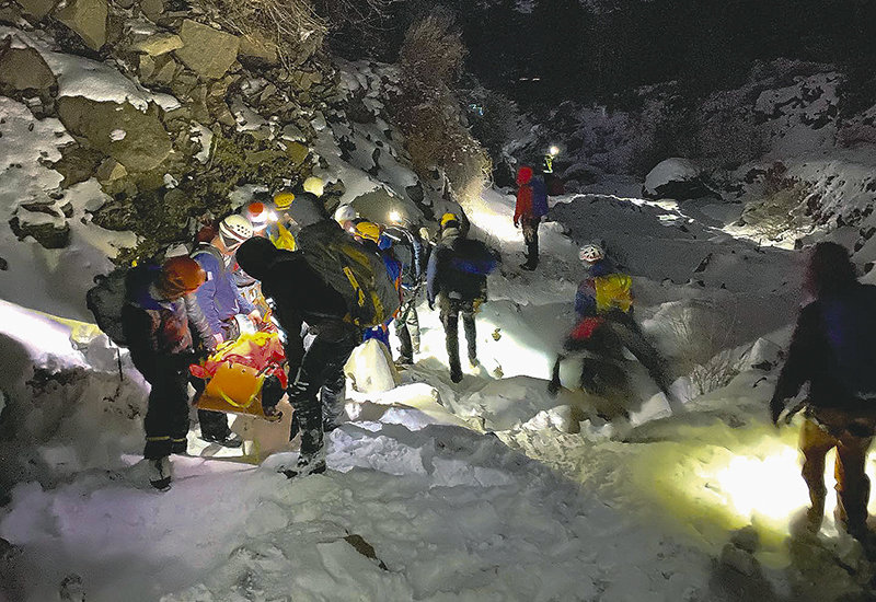 An injured climber is lowered from the Broken Heart ice flow on the South Fork following a Saturday morning fall. Search and rescue volunteers and medical personnel spent all afternoon and evening rescuing the 42-year-old Billings man.