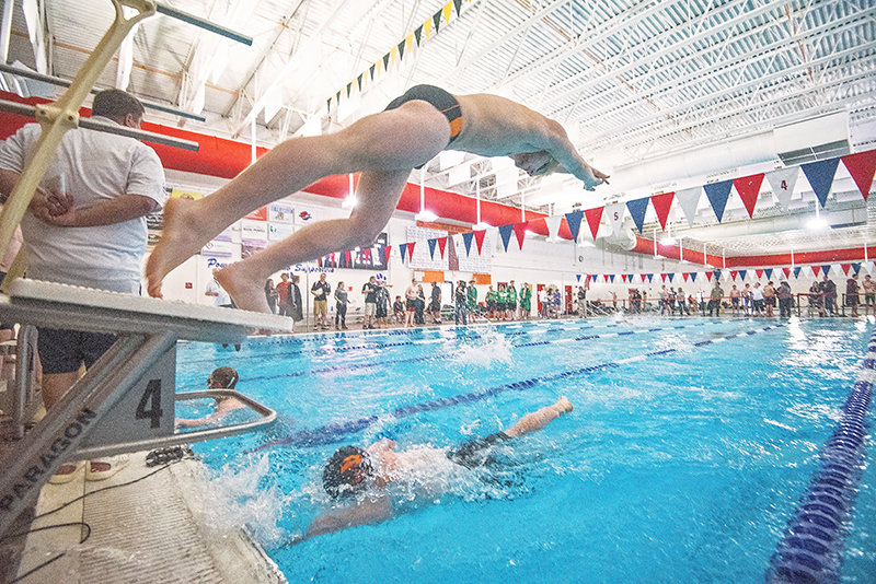 Panther swimmer Richard Spann launches from the starting block as Ben Cannizzaro finishes his leg of the 200 free relay during the 3A West Conference swim meet at the Powell Aquatic Center on Friday. The team finished third in the event in Saturday's finals, with a time of 1:39.95.