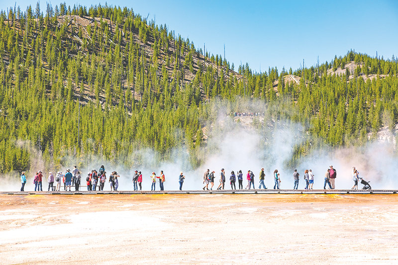 The boardwalks at popular Yellowstone National Park destinations like the Midway Geyser Basin — pictured here in August — could be less crowded this summer, as experts expect the new coronavirus outbreak in China to lead to a drop in visits. In a typical year, hundreds of Chinese residents visit the park.