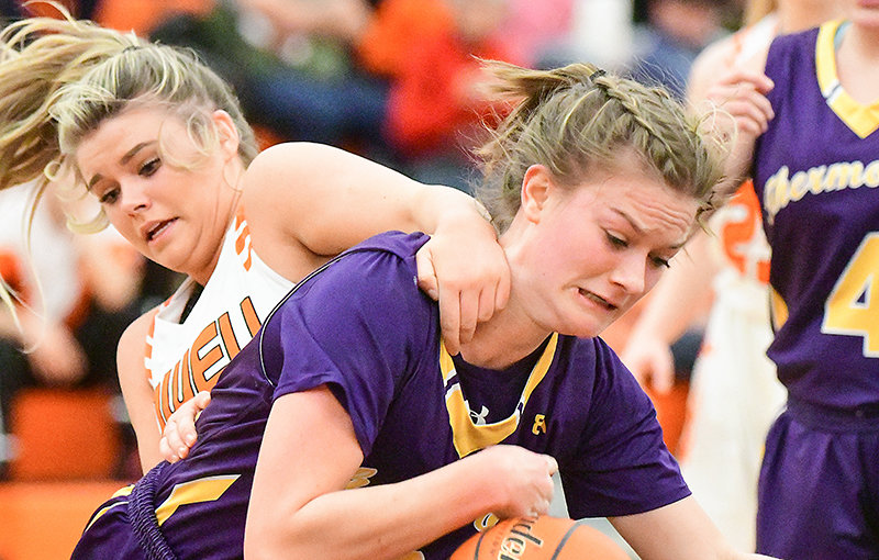 McKenna Bomengen, a Bobcat senior, fends off the fierce defense of Powell High School senior Kortny Feller Friday night at home. The Panthers lost to Thermopolis, 49-39.