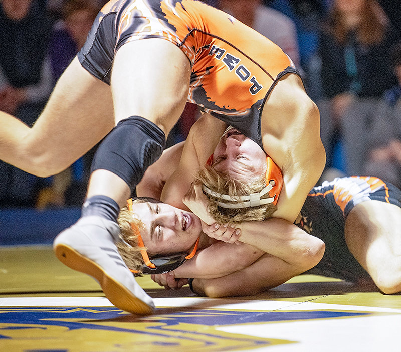 Panther junior Riley Bennett uses momentum to continue through a hold against Worland's Colon Woffinden Friday evening in Cody. Bennett won the match by a 9-6 decision.