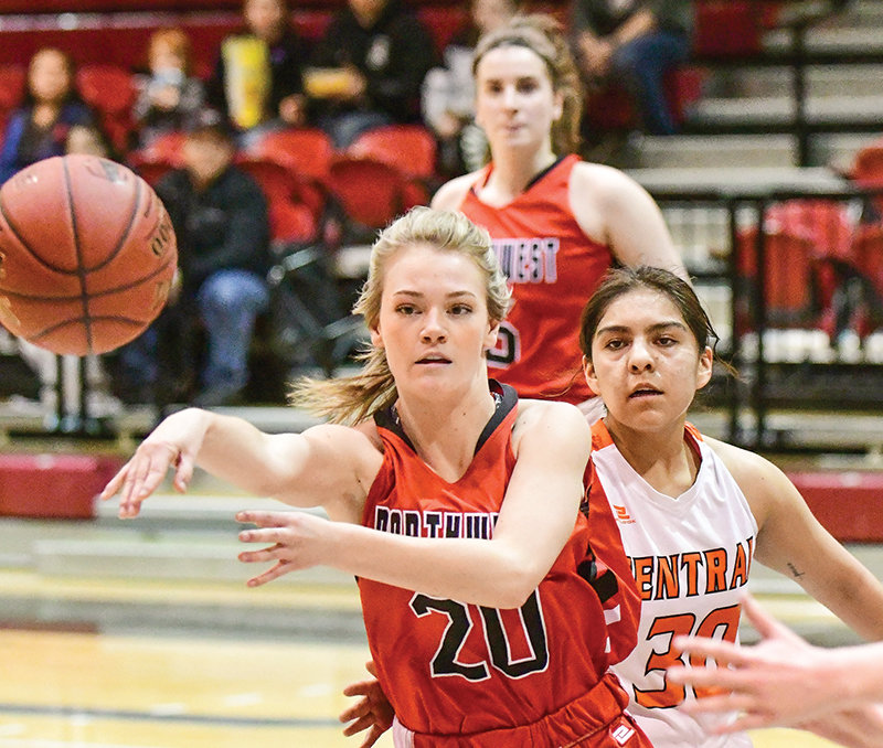 Former Powell Panther Aubrie Stenerson, now a Trapper freshman, fires a pass in Northwest's game versus Central Wyoming. The Trappers saw their 31-25 halftime lead morph into a 71-64 loss.