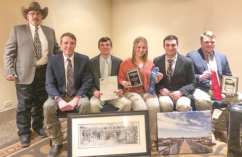 NWC Livestock Judging Coach Quin LaFollette stands with the team. From left: Wyatt Deskins of Chehalis, Washington; Jaydon O'Hare of Livingston, Montana; Courtnee Clairmont of Ronan, Montana; Kyle Russell of Kimberly, Idaho; and Ethan Beery of Circle, Montana.