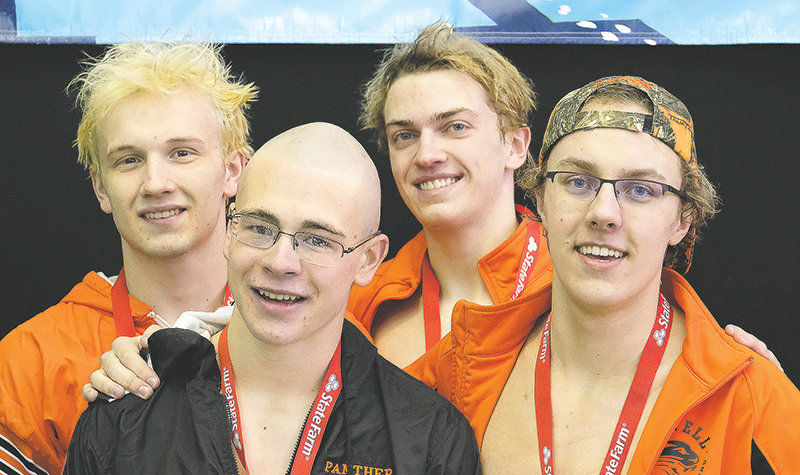 The Powell High School 200 free relay team of (from left) Richard Spann, Tarren Blackmore, Jay Cox and Nate Johnston stand on the awards podium at the Class 3A state swimming and diving championships in Laramie on Friday. The quartet ultimately took the state title in the event and broke a 25-year-old PHS record in the 200 medley relay. Johnston, meanwhile, won a state title in the 100 breastroke.
