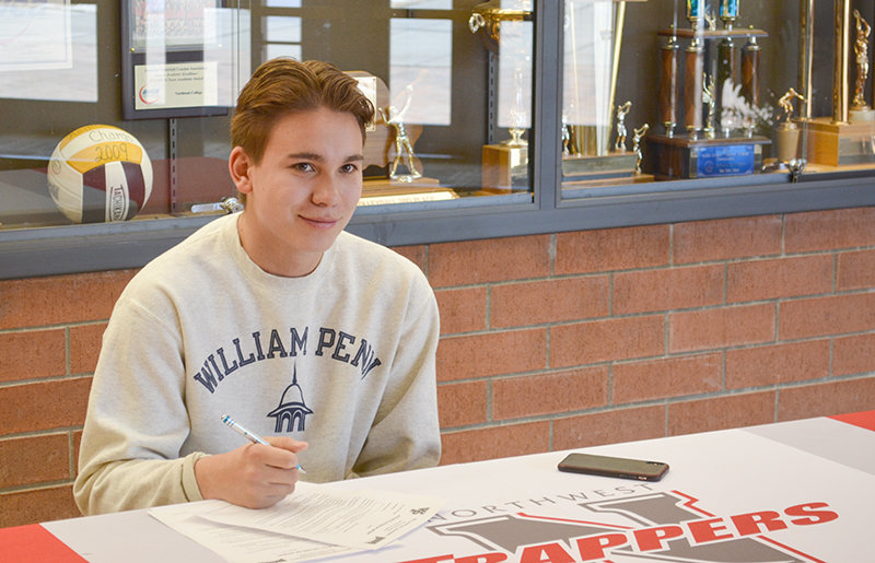 Northwest College freshman Ryan Bevins grins Wednesday while preparing to sign paperwork committing him to continue his soccer career at William Penn University. Bevins received a scholarship to play soccer at the four-year school in Oskaloosa, Iowa.