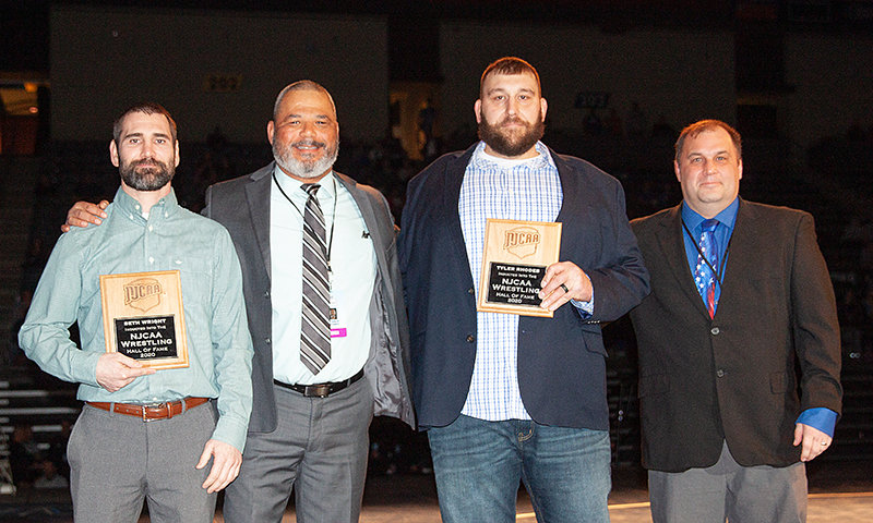 National champions Seth Wright (left) and Tyler Rhodes flank Northwest wrestling coach Jim Zeigler during their induction into the NJCAA Wrestling Hall of Fame. At right is Aaron Cooper, head coach at Mercyhurst (Pennsylvania) and chair of the hall of fame committee.