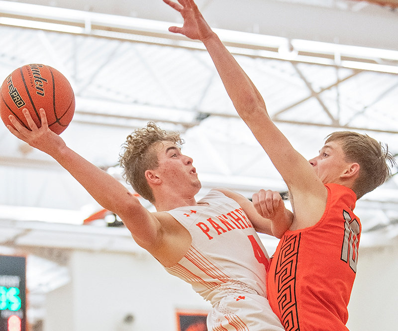 PHS junior Mason Marchant shoots during a home game against Worland during the recent season.