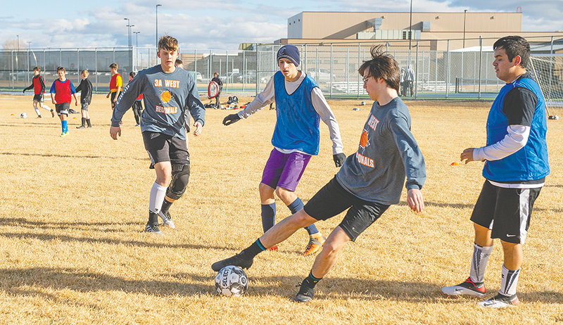 Landon Sessions works to control the ball during the Powell High School boys' soccer team practice on March 12 — before all practices and competitions were suspended due to the pandemic. Although Wyoming schools will remain closed until at least April 17, PHS officials are still holding out hope for a truncated spring sports season.
