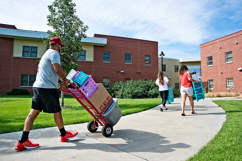 Northwest College students move items into a dorm in August. The NWC Board of Trustees is tabling its housing plan to get more input from the community.