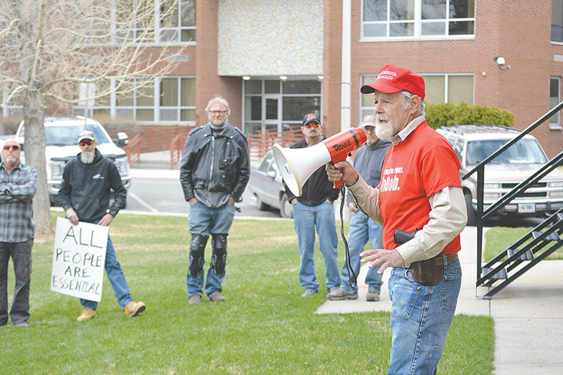 Bob Berry addresses a crowd of dozens at Friday afternoon's 'Reopen Wyoming' rally at Cody City Park, calling the COVID-19 pandemic and public officials' response 'one of the grandest hoaxes in the history of the world.' Attendees at the rally decried the impact that Wyoming's public health orders have had on businesses and workers and called on Gov. Mark Gordon to drop the restrictions.