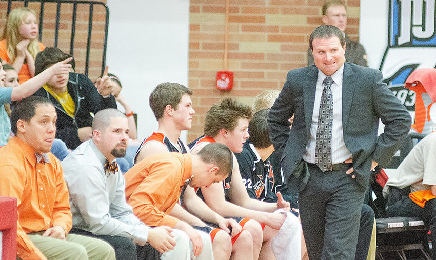 Mike Heny, seen leading the Panthers at the 2013 Class 3A State Basketball Tournament, is retaking the reins of the boys program. Heny was named as the new boys' basketball head coach last week.